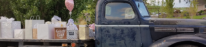 Old pickup truck being used as a gift table at a wedding
