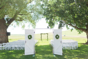 beautiful barn doors was placed at the entrance leading to the altar